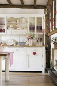White kitchen freestanding dresser. assorted vintage and s=decorative pottry, crockery and glassware, oak wood beams and timber frame real home 25 BH 11/2009 pub orig